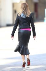 AMANDA HOLDEN in Leather Jacket and Skirt Out in London 03/27/2020