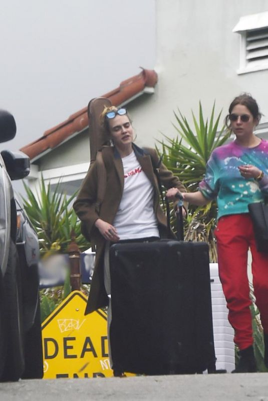 ASHLEY BENSON and CARA DELEVINGNE Out with Their Luggage in Los Angeles 03/16/2020