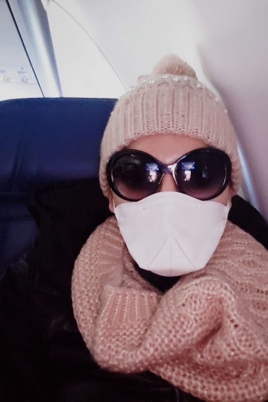 BLANCA BLANCO Wears Mask and Gloves while Flying to Detroit 03/13/2020