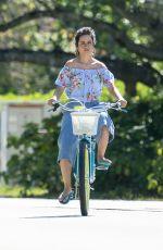 CAMILA CABELLO Riding a Bike Out in Miami 03/30/2020