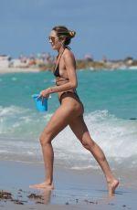CANDICE SWANEPOEL in Bikini at a Beach in Miami 03/18/2020