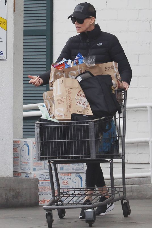 CHARLIZE THERON Stocks Up on Groceries in Beverly Hills 03/20/2020