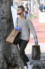 CHARLOTTE MCKINNEY Wears Gloves while Shopping at Erewhon in Santa Monica 03/17/2020