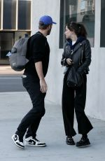 DAKOTA JOHNSON and Chris Martin at Crossroads in Los Angeles 03/11/2020