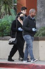 DEMI LOVATO with Black Face Mask and Disposable Gloves Shopping at Erewhon in Los Angeles 03/15/2020