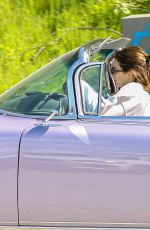 KENDALL JENNER in Her Purple 1960 Cadillac Eldorado Convertible Driving Out in Los Angeles 03/18/2020