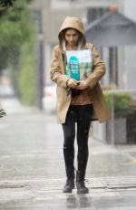 LILY COLLINS Out in the Rain to Pick Up Dog Food in Los Angeles 03/13/2020