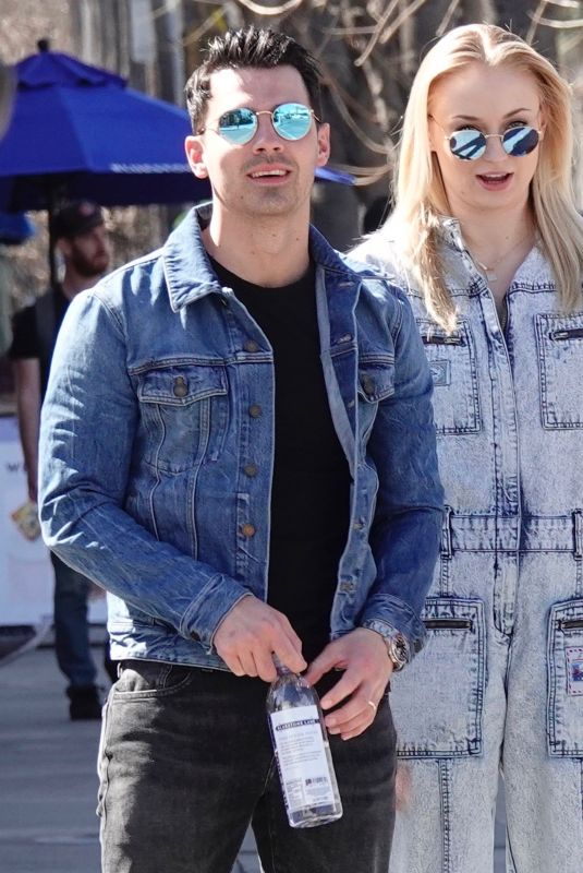 Pregnant SOPHIE TURNER in a Washed Out Denim Jumpsuit Out wioth Joe Jonas in Los Angeles 03/03/2020