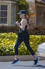 REESE WITHERSPOON Out Jogging in Brentwood 03/23/2020
