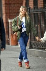 SIENNA MILLER in Denim Shows a Diamond Rring Out in New York 03/11/2020