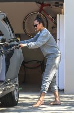 CHRISSY TEIGEN Outside Her Home in Malibu 04/16/2020