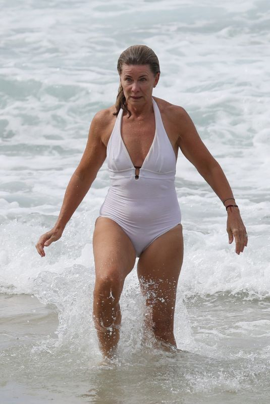 DEBORAH HUTTON in Swimsuit at a Closed Beach in Sydney 04/02/2020
