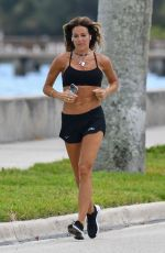 KELLY BENSIMON in Shorts Out Jogging in Palm Beach 04/07/2020