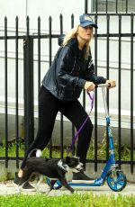 MALIN AKERMAN Rides a Scooter with Her Dog in Los Angeles 04/07/2020