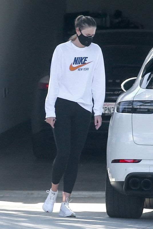 MARIA SHARAPOVA Inspects her Car After Getting It Delivered 04/21/2020