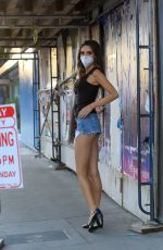 MEGAN PORMER in Denim Shorts Wearing Mask Out in Hollywood 04/15/2020