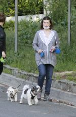 MILLA JOVOVICH Out with Her Dogs in Los Angeles 04/24/2020