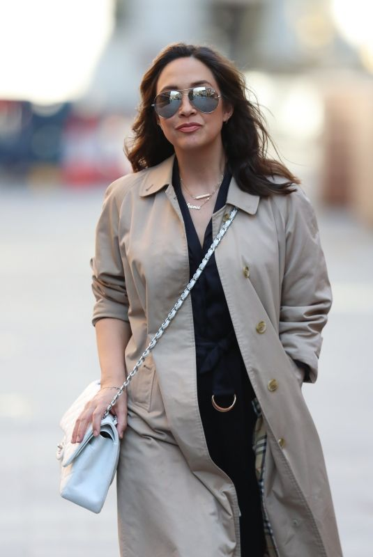 MYLEENE KLASS in a Trench Coat Arrives at Smooth Radio in London 04/04/2020