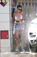 CJ FRANCO in Denim SHorts and Bikini Top Out Washing Her Car in Santa Monica 05/02/2020