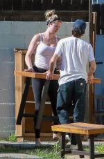 IRELAND BALDWIN Offloading a Table and Chairs from Her Truck in Los Angeles 05/22/2020