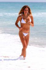KELLY BENSIMON in a White Bikini at a Beach in Palm Beach 05/28/2020