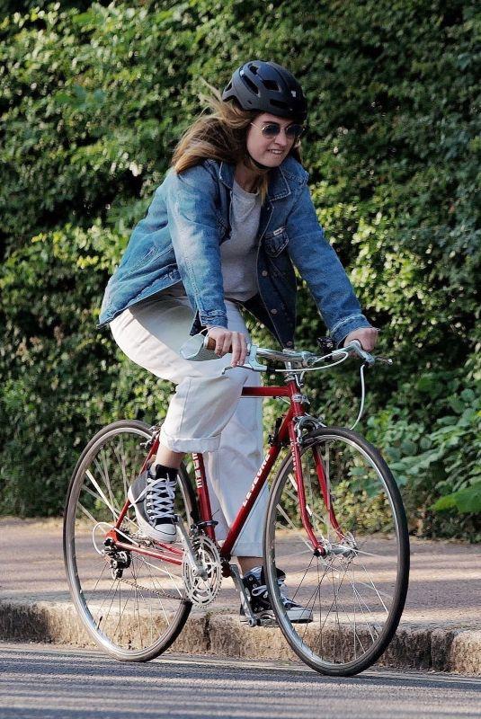 LILY JAMES Out Riding a Bike in London 05/15/2020