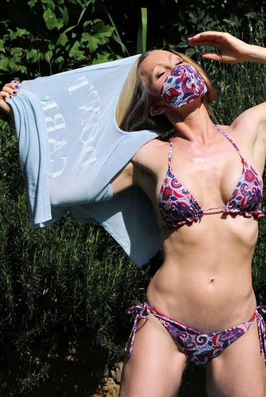 CAPRICE BOURET in Bikini and Matching Mask Sunbathing at a Park in London 05/31/2020