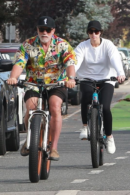 CHRISTINA and Arnold SCHWARZENEGGER Out Riding Bikes in Brentwood 06/15/2020