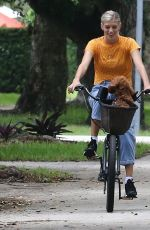 DEVON WINDSOR Out Riding a Bike with Her Dog in Miami 06/06/2020