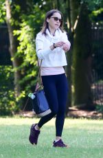 EMILIA CLARKE Out with Her Dog at a Park in London 06/23/2020