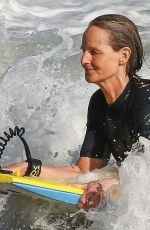 HELEN HUNT in Wetsuit Bodyboarding at a Beach in Malibu 06/13/2020