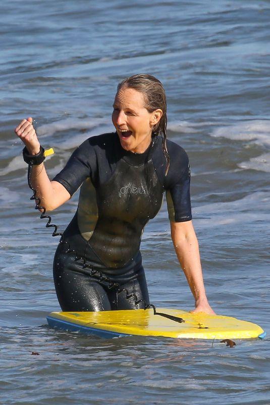HELEN HUNT in Wetsuit Bodyboarding at a Beach in Malibu 06/13/2020