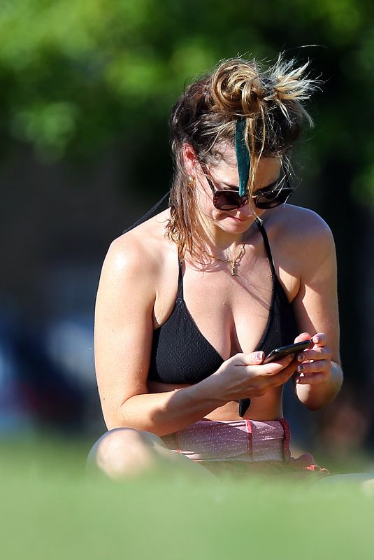 LILY JAMES in Bikini Top Sunbathing at a Park in London 06/25/2020