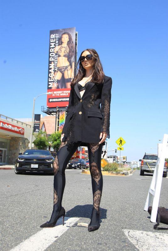 MEGAN PORMER in Front of Her Billboard on Sunset Blvd in Hollywood 06/04/2020