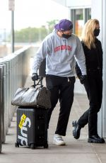 NICOLA PELTZ and Brooklyn Beckham at JFK AIrport in New York 06/25/2020