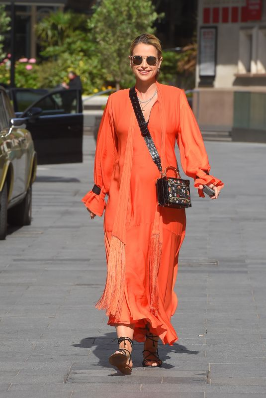 VOGUE WILLIAMS in a Orange Dress Leaves Global Radio in London 06/07/2020