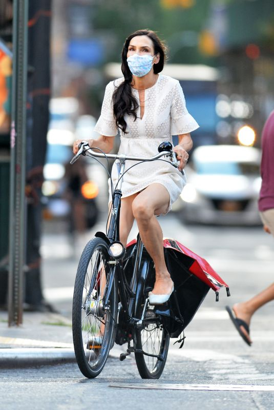 FAMKE JANSSEN Out Riding a Bike in New York 07/14/2020