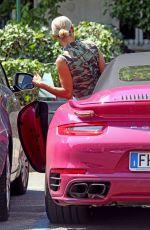 MICHELLE HUNZIKER Drives Her Pink Porsche Out in Milan 07/28/2020