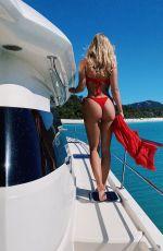 NATASHA OAKLEY in a Red Bikini at a Boat - Instagram Photos 07/30/2020