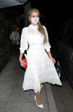 PARIS HILTON in a White Dress at Madeo Restaurant in Beverly Hills 06/30/2020