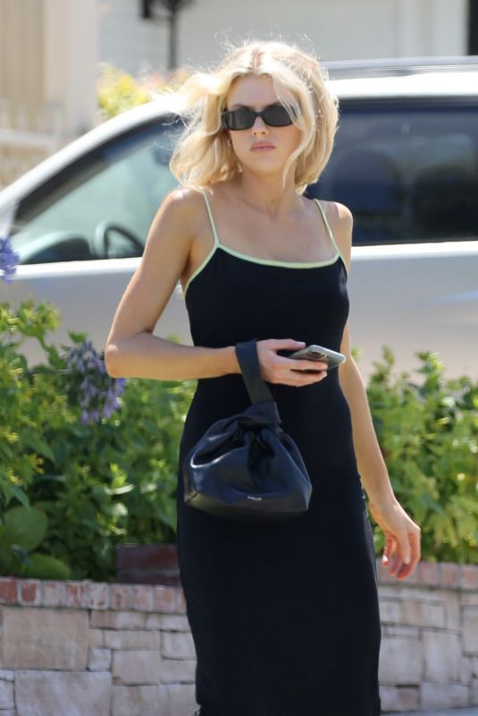 CHARLOTTE MCKINNEY in a Tight Black Dress Out in Los Angeles 08/10/2020