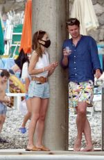 EMILIA CLARKE at a Restaurant on Vacation in Positano 08/07/2020