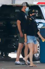 TIFFANI THIESSEN in Denim Shorts at a Car Wash in Los Angeles 08/12/2020