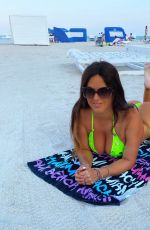 CLAUDIA ROMANI in a Neon Green Bikini at a Beach in Miami 09/20/2020