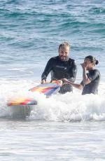 ZOE SALDANA in Wetsuit at Surf Session in Malibu 09/20/2020