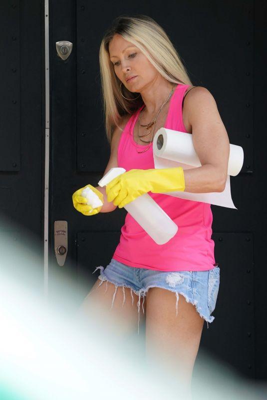 CAPRICE BOURRET in Denim Shorts Disinfecting Her Front Door in London 10/06/2020