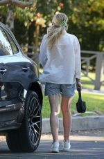 DAKOTA FANNING in Denim Shorts Out in Los Angeles 10/13/2020
