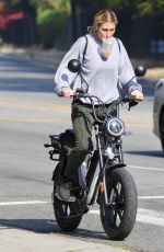 EMMA SLATER Driving Her Electric Bike Out in Studio City 10/19/2020