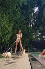 KATE BECKINSALE in Bikinis with her Dogs at a Pool - Instagram Photos 10/04/2020