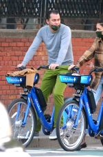KATIE HOLMES and Emilio Vitolo Jr. Out Riding Citi Bikes in New York 10/20/2020